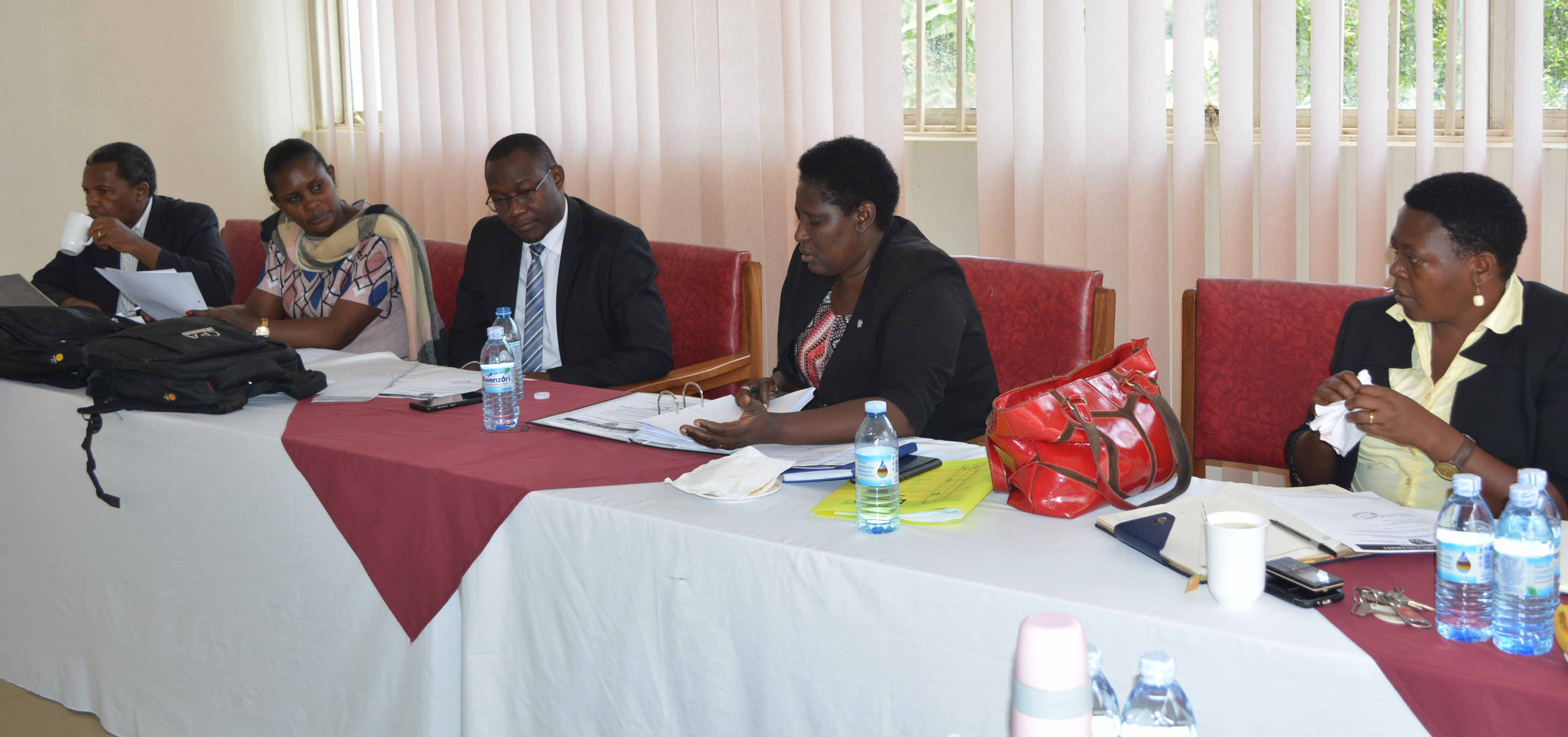 Ministry of Education and Sports officials in a meeting with the University Top Management team