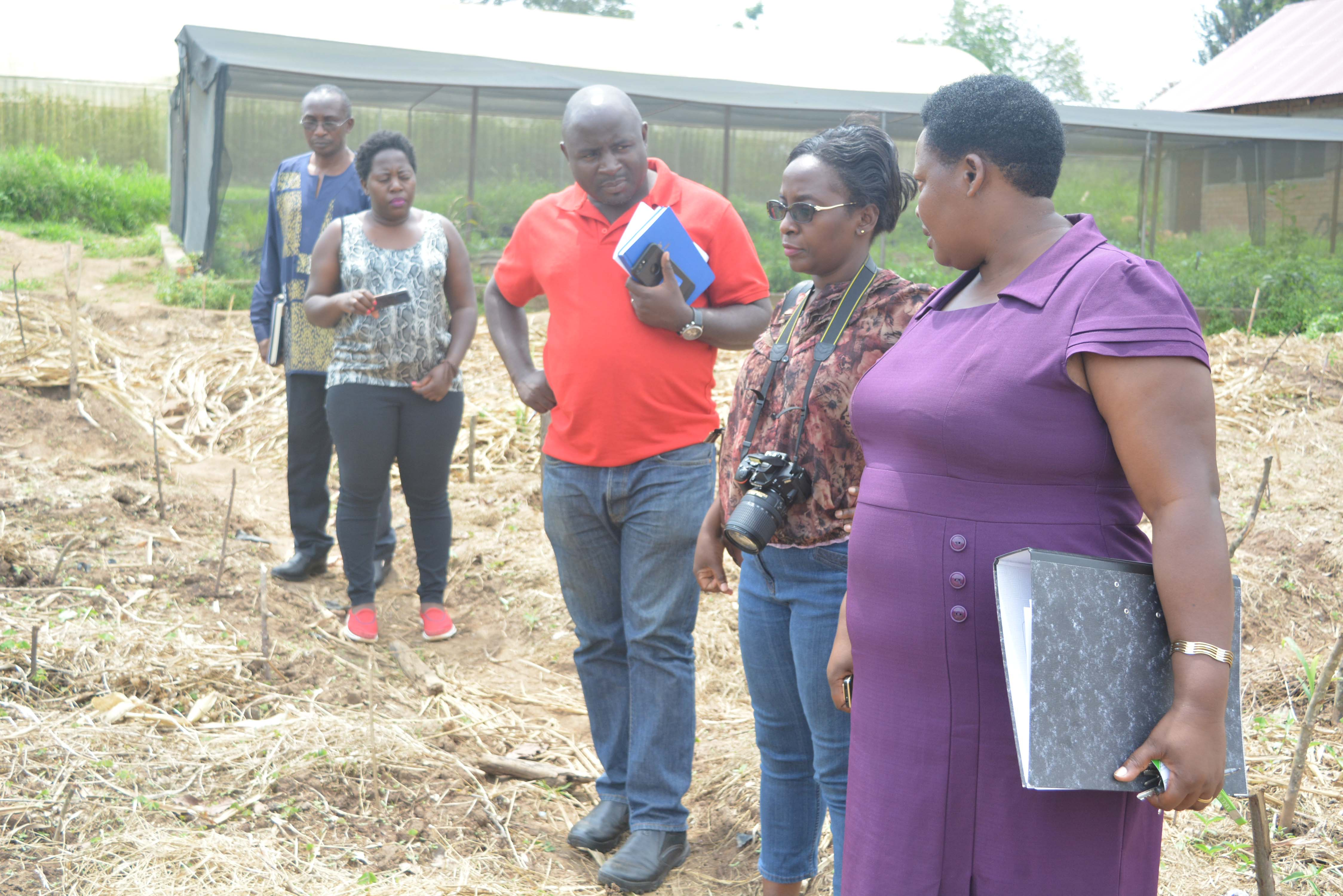 Mrs. Deborah Akatwetaba a Lecturer in the Department of Agriculture, Agribusiness, and Environment, Dean Faculty of Agriculture, Environmental Sciences & Technology and NAADS team touring around projects.