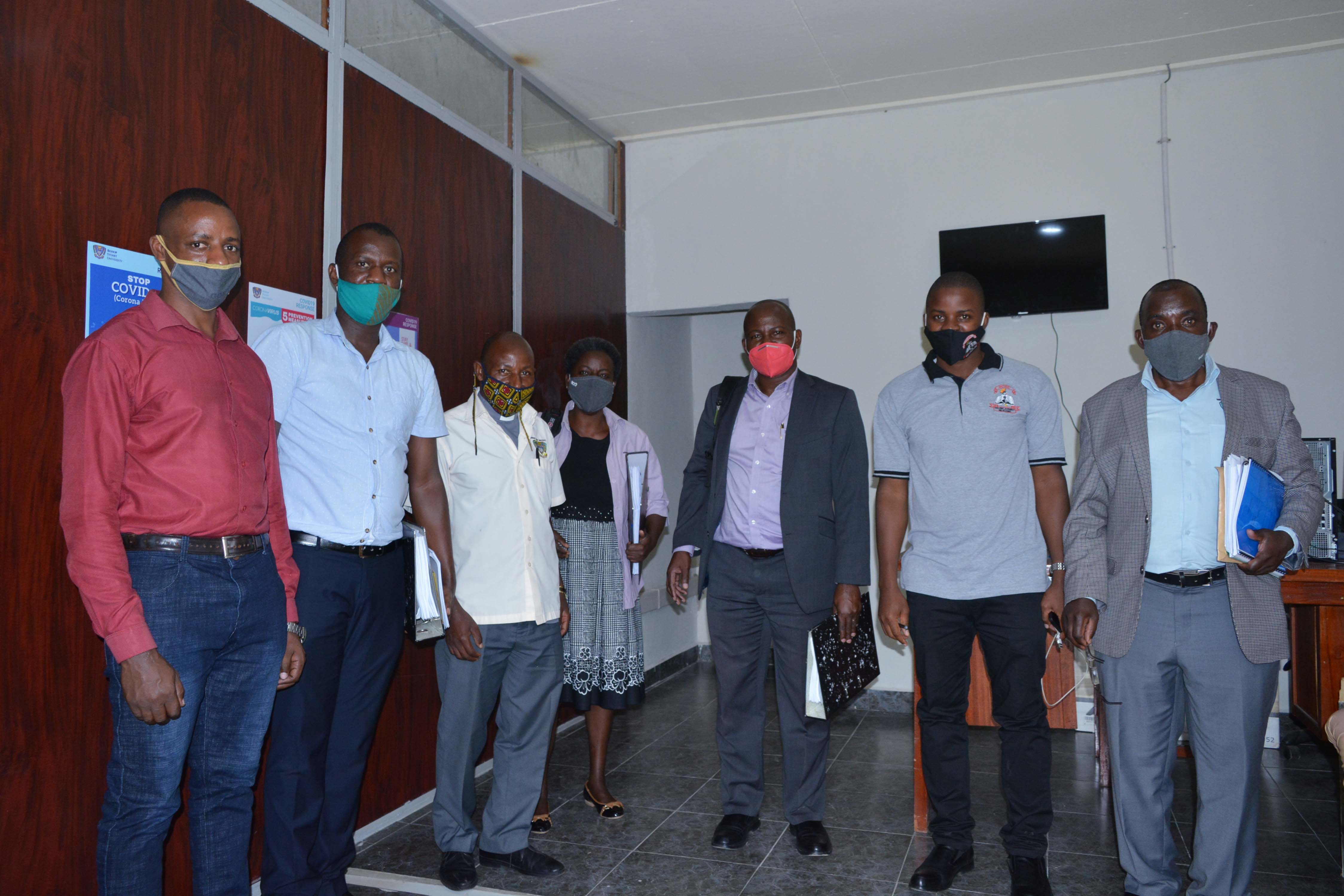 ODEL team posing for a photo with NCHE Officials in the FAR Center building