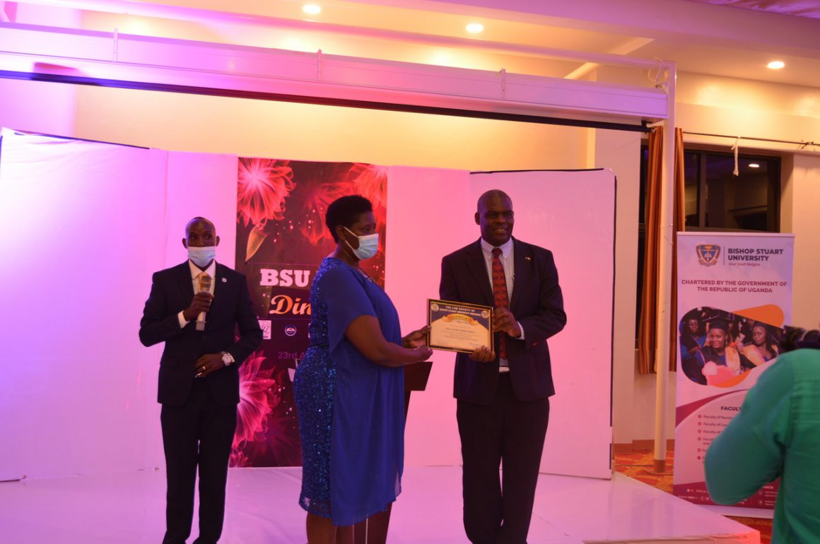 The VC - Prof. Maud Kamatenesi Mugisha hands over a certificate of appreciation to the Guest of Honor Hon. Justice Mike Chibita at Lawyers annual dinner- Hotel Triangle, Mbarara