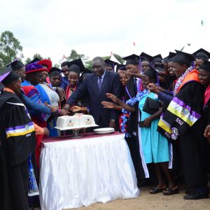 HESFB Team and students funded by HESFB cutting cake at 15th BSU Graduation